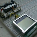 A Bare Bones Board (Arduino clone) with a small LCD.